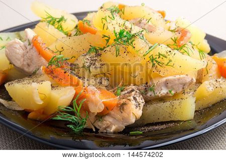 Dish Of Stewed Potatoes With Chicken And Spices