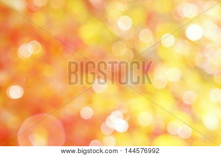 Abstract summer yellow and red background with white bokeh and patches of light