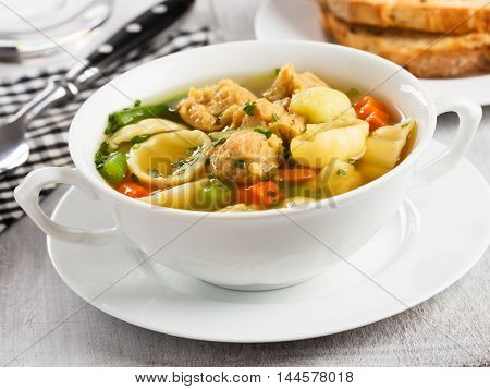 Vegan noodle soup with soy chunks and vegetables