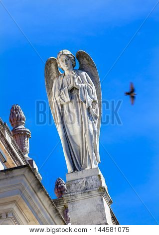 Stone Angel Dove Basilica of Lady of Rosary Bell Tower Fatima Portugal. Church created on site where three Portuguese Shepherd children saw Virgin Mary of the Rosary. Basilica created in 1953.
