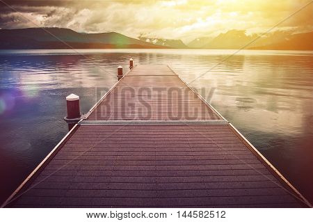 Montana Glacier Lake Scenery. Lake McDonald Wooden Deck Scenic Point. Glacier National Park Montana United States.