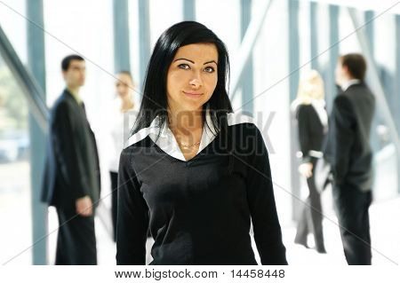 Business people in office (WARNING! Focus only on the lady in front of image)