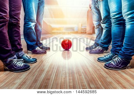 People near bowling ball