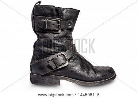 Worn old black biker unisex boots isolated on white