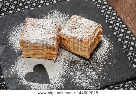 Two piece of Mille-Feuille puff pastry known as the Napoleon vanilla slice