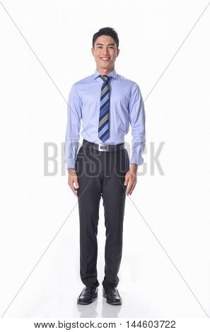 Full body young businessman in sunglasses standing on white background