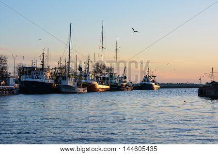 Old fishing trawlers at sunset, Black Sea, Bulgaria