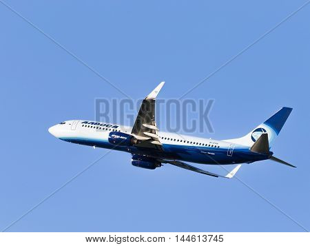 Moscow - 31 July 2016: large passenger plane Boeing 737-83N / W Alrosa-Avia airline flies to Domodedovo airport and on a background of blue sky July 31 2016 Moscow Russia