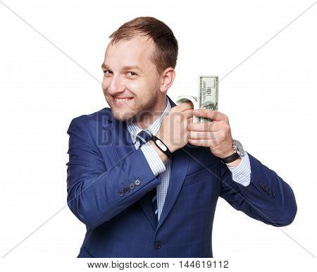 Portrait of a good-looking handsome businessman counting pack of dollars against white background. Young man with big money pile, earn a lot and succesfull business concept.
