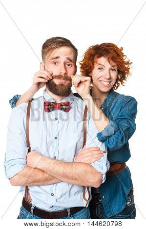 studio portraits man with beard and woman with red curly hair. Isolated on a white background