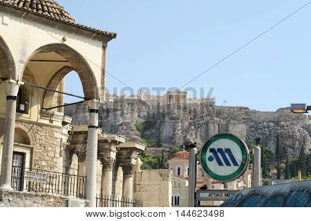Athens, Greece - August 06 2016: Athens metro sign at Monastiraki metro station. This station, with an entrance view to Acropolis, serves as an interchange between Lines 1 and 3 of Athens metro.