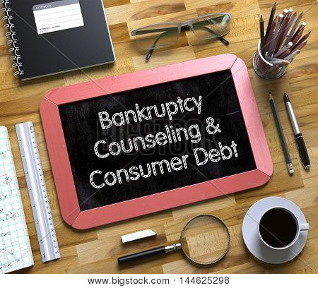 Bankruptcy Counseling and Consumer Debt - Red Small Chalkboard with Hand Drawn Text and Stationery on Office Desk. Top View Small Chalkboard with Bankruptcy Counseling and Consumer Debt 3d Rendering