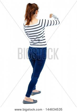 back view of woman funny fights waving his arms and legs. Rear view people collection. The girl in the striped sweater is back and fighting.