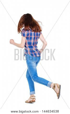 back view of running woman. beautiful girl in motion. Girl in plaid shirt with fluttering hair runs off into the distance.