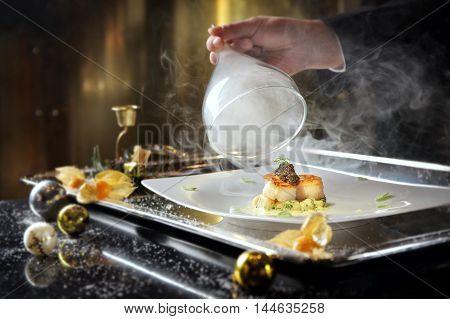 Pan seared diver scallops with smoked potato gnocchi and Oscietra caviar