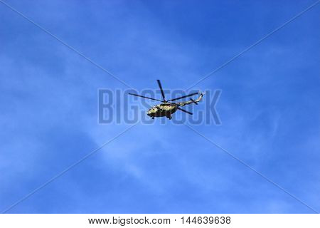 Syzran Russia August 24 2016. military helicopter MI-16 military aircraft Russia with arms in the sky piloted by cadet and performs a training flight