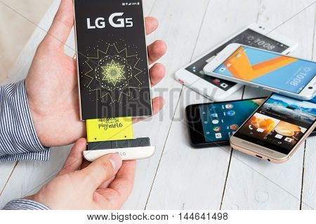 WROCLAW POLAND- AUGUST 18th 2016 : Proffesional advisor shows new project of LG G5 which is an Android smartphone developed by LG Electronics. G5 got replaced alternative add-on modules such as a camera grip or a high-fidelity audio.