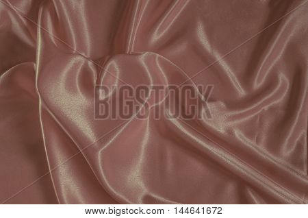 Texture pink nacre satin cloth with the image of heart