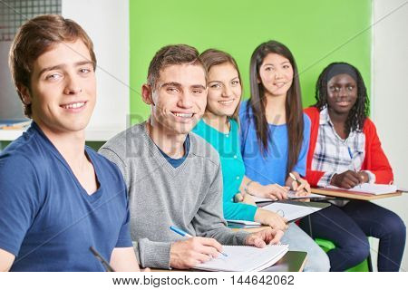 Interracial group of teenage students on a test