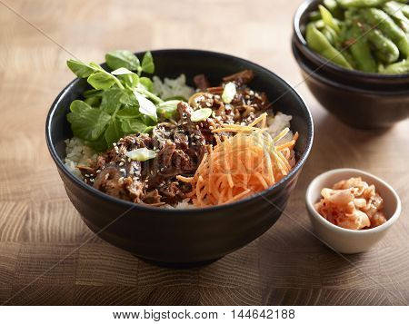Lifestyle Beef Donburi with rice kimchi and boiled soyal bean