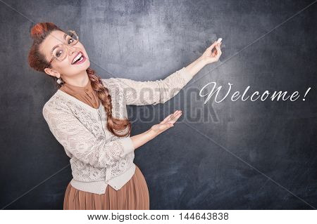 Happy Teacher With Piece Of Chalk