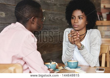 Close Up Portrait Of African American Friends At Cafe Having Serious Conversation, Fashionable Hipst