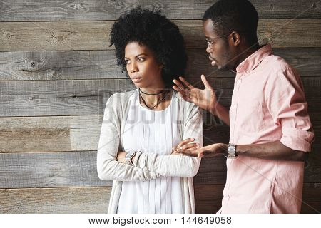 Young Displeased Black Male Gesturing In Indignation, Arguing With His Stylish Girlfriend, Who Is St