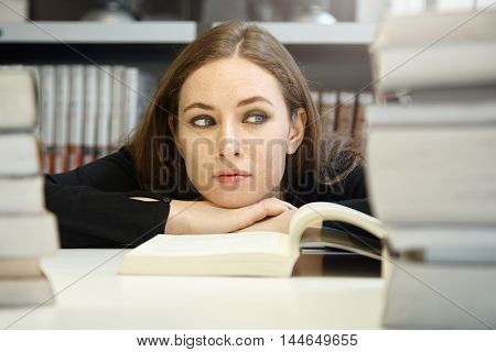 Bored High-school Female Student Looking Away, Sick And Tired Of Reading Boring Textbooks, Sitting A