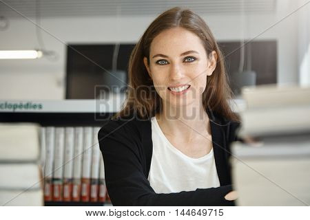 Close Up Shot Of Attractive Brunette Female Professor With Freckles Wearing Black Jacket, Smiling Wh