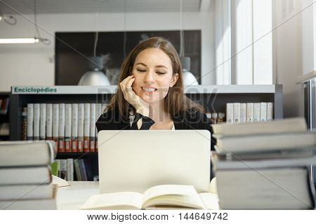 Undergraduate Student Girl Preparing For Exams, Working On Laptop, Using Wireless Internet Connectio
