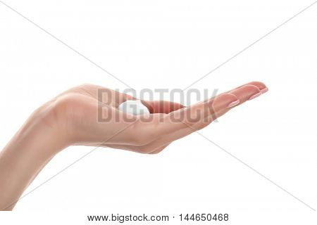Female hand with cosmetic cream, isolated on white
