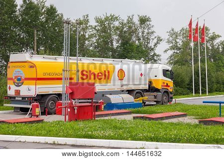 LENINGRAD REGION, RUSSIA - JULY 31 2016: Shell Oil Truck at the gas station Shell. Royal Dutch Shell or Shell is an Anglo-Dutch multinational oil and gas company