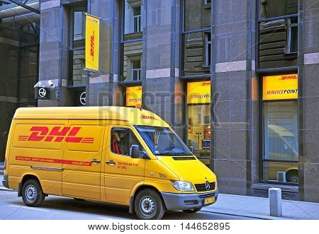 BUDAPEST HUNGARY - MAY 20: FDHL van in the street of Budapest city on May 20 2016. DHL Express is a division of the German worldwide logistics company.