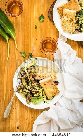 Honey glazed tofu with vegetables on a white plate