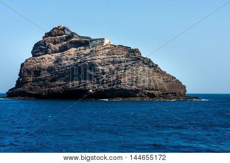 Cape Verde Ilheu dos Passaros. Island with the lighthouse near Sao Vicente Island