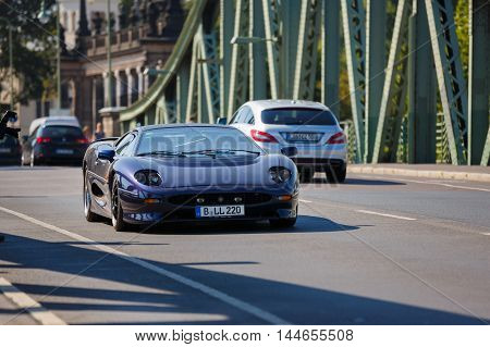 Potsdam Germany - August 27 2016: Sportcar Ferrari goes on a Glienicke Bridge in open motor Rally Hamburg-Berlin Klassik the date of August 25-27