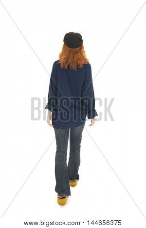 Funny female farmer from Holland walking away on wooden clogs isolated over white background