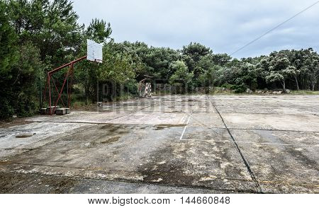 Old Abandoned School Sports Court Or Schoolyard For Different Activities.