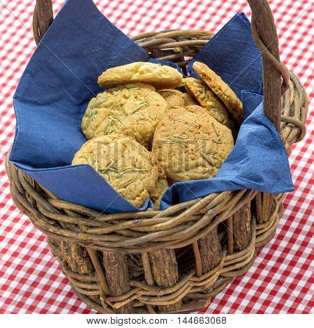 Special biscuits cake in wooden basket with tablecloth