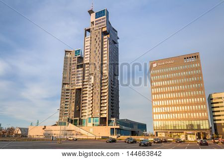 GDYNIA, POLAND - APRIL 8, 2016: Modern architecture of Sea Towers skyscraper at sunset, Gdynia. Sea Towers is the 10th tallest building in Poland (143,6 meters) with 38 floors.