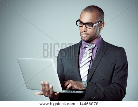 business black man whit laptop