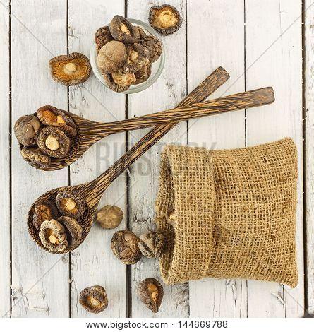 Top View Of Dry  Shiitake Mushrooms On White Wood