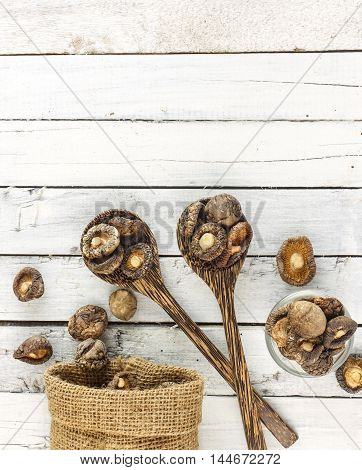 Food Background - Dry  Shiitake Mushrooms On White Wood
