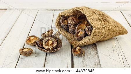 Dried Shiitake Mushrooms On White Wood