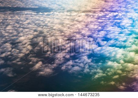 Airplane flying above cumulus clouds. View of sky from aircraft long distance travel by airtransport. Russia