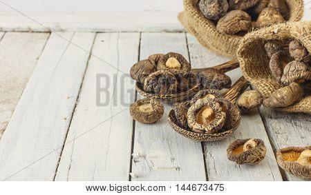 Dried Shiitake Mushrooms On White Wood
