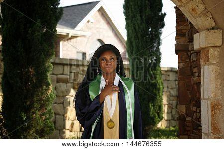 Beautiful African-American graduate in modern neighborhood environment