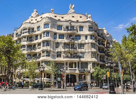 BARCELONA SPAIN - JULY 5 2016: Casa Mila better known as La Pedrera. This famous building was designed by Antoni Gaudi