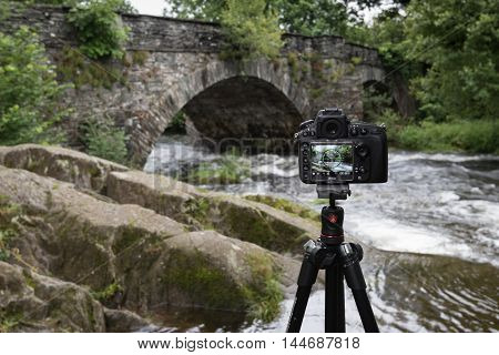 Ambleside, England, July 10, 2016. Skelwith Bridge in the Lake District National Park, Cumbria, England in the Live View screen of a Nikon full frame camera on a Manfrotto tripod. The camera spirit level is used to maintain a level horizon.