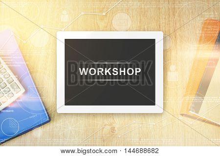 workshop word on tablet with soft light vintage effect